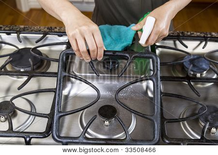 Spraying Down Stove Top Range For Cleaning