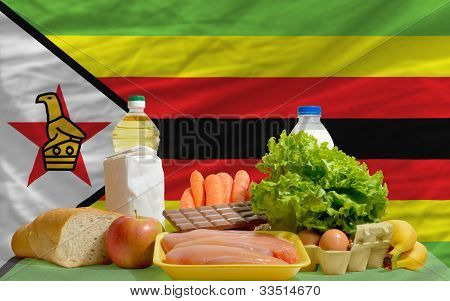 Basic Food Groceries In Front Of Zimbabwe National Flag
