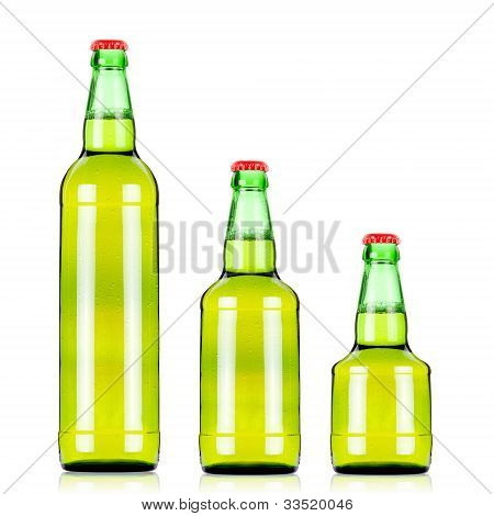 Three  Green Beers Bottles Of Different Size Over White Background/green Beer Bottles