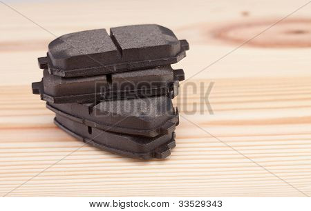 Brake Pads On A Woden Workbench With Tools