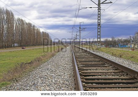 Railroad Embankment And A Road