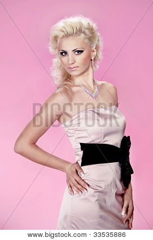 Beautiful Young Lady Wearing Pink Elegant Dress Over Pink