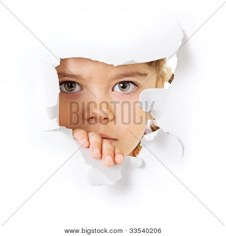 Child's Face Looking Through A Hole In Paper