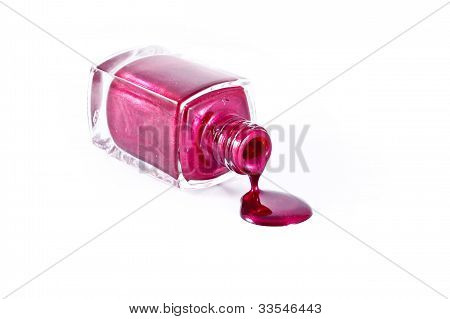 Red Nail Polish Bottle With Splatters Isolated On White Background