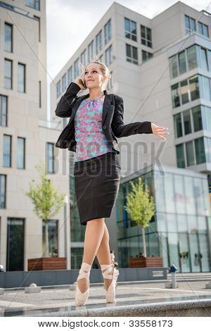 Business ballet dancer on the phone