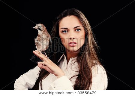 Portrait Of Beautiful Girl In Fashion Style With Bird On The Hand