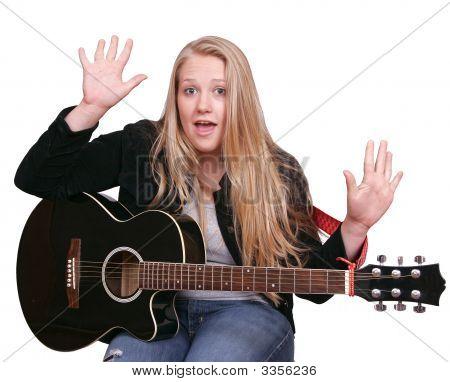 Girl In Black Playing Guitar