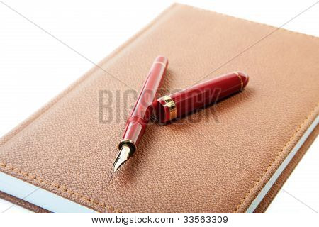 Fountain Pen Close-up And  Leather Organizer Isolated On A White