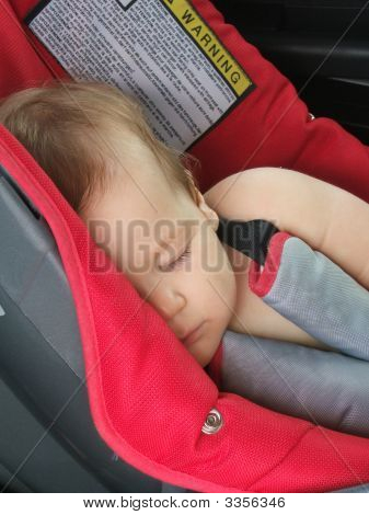 Beautiful Baby Girl Sleeping In A Baby Car Seat
