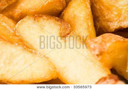 Fried potato wedges