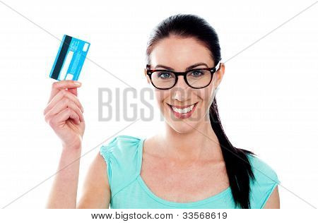 Portrait Of Young Smiling Woman Holding Credit Card