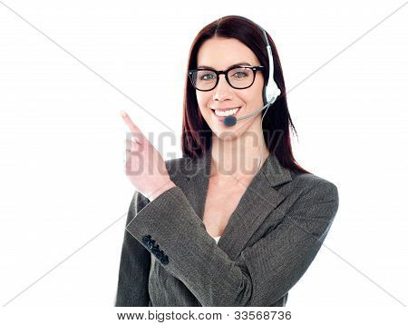 Female Operator With Headset Pointing At Something