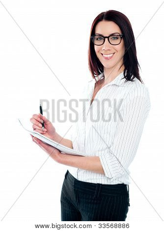 Smiling Business Woman Writing On Viral Notedpad
