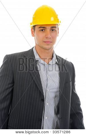 Businessman in the construction helmet