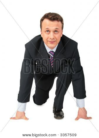 Businessman In Pose Of Low Start