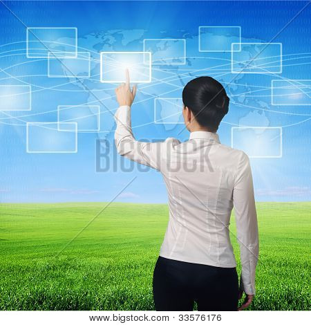 woman Pushing Virtual Icons With  Finger