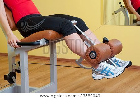 Young woman doing legs workout in the gym