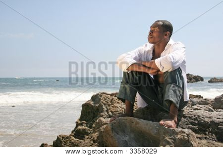 Handsome African American Man On The Beach Thinking