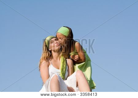 Happy Child Kissing Mother