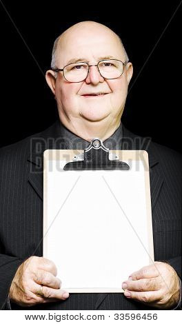 Senior Pensioner Holding A Clipboard