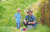 Planting Flowers. Growing Plants. Take Care Of Plants. Boy And Father In Nature With Watering Can. G poster