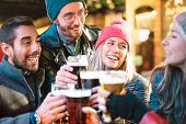 Friends Drinking Beer At Brewery Bar Outdoor On Winter Time - Friendship Concept With Young People H poster