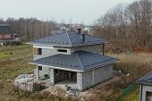 Modern Roof Made Of Metal. Corrugated Metal Roof And Metal Roofing. New Houses Under Construction In poster