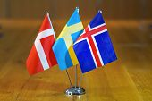 Three Flags On The Table. Flags Of Denmark, Sweden And Iceland. Flags Of Denmark, Sweden And Iceland poster