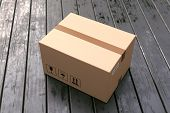 Cardboard Box On Porch Floor In Front Of Entrance Door. Doorstep Parcel Delivery, Free Shipping, And poster