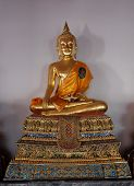 Gilded Buddha Statue Sitting In Lotus Position. Statue From A Buddhist Monastery. poster
