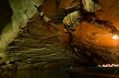 Inside Of Konglor Caves. Kong Lor Cave Interior With Illuminated Stalactite Formations. Biggest Cave poster