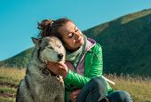 Portrait Of Young Cute Husky Dog With Owner. Friendship, Pet And Human. Dog Walking With Owner Outdo poster