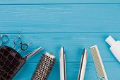 Hairdresser Tools On Blue Wooden Background. Hairdressing Equipment On Color Background. Space For T poster