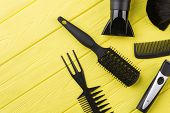 Hairdresser Equipment On Yellow Wooden Background. Tools For Hairdresser. poster