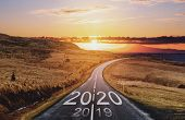 2020 And 2019 On The Empty Road At Sunset. New Year Concepts poster