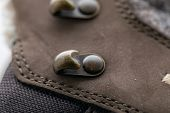 Close-up Picture Of Brass Shoe Hooks. Detail Of Trekking Shoes Hook And Loop For The Strap. poster