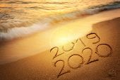 Goodbye 2019 Happy New Year 2020 Lettering On Sunset Beach With Wave And Sea. Handwritten Inscriptio poster
