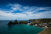 The Picturesque And Popular Tourist Destination Of Kynance Cove In Cornwall Showing The Beautiful Ru poster