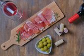 Traditional Spanish Tapas, Snacks Slices Of Serrano Ham, Fresh Chopped Jamon, Olives On Wooden Board poster