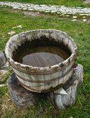 foto of washtub  - An old wooden washtub filled with water - JPG