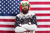 Celebrate With Confidence. Confident Hipster American Flag Background. Bearded Man Keep Arms Crossed poster