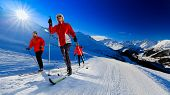 A family group of cross country skiers on a sunny winter morning in Swiss Alps, 4 Valleys Thyon, Swi poster