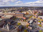Lowell Historic Downtown, Canal, Marrimack River And Historic Mills Aerial View In Fall In Lowell, M poster