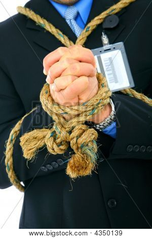 Closeup Hand Of Businessman Tied With Rope