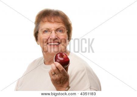 Attractive Senior Woman With Apple
