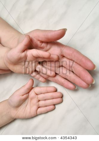 Hands Of Mother And Children