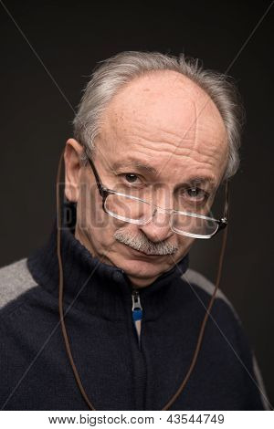 An Elderly Man With Glasses