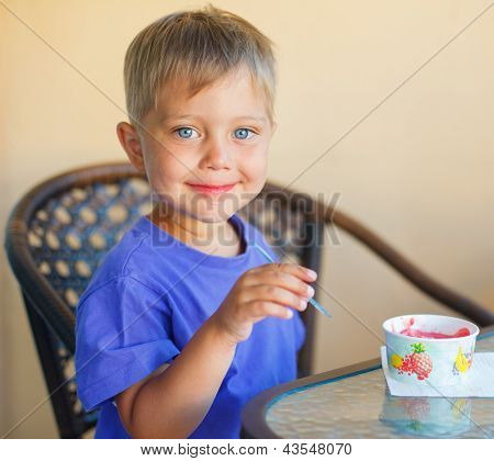 Boy child in cafe