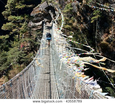 hanging footbridge ower the dudh koshi nadi river- sagarmatha national park - nepal