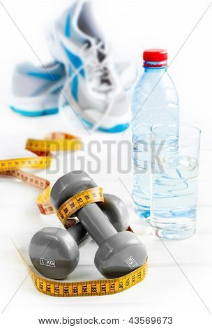 grey dumbbells and exercise